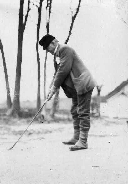 John Marshall Harlan golfing