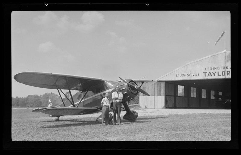 Men next to airplane
