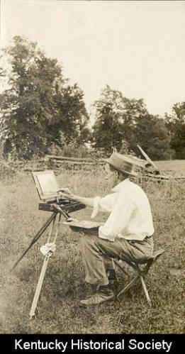 Paul Sawyier painting in a field