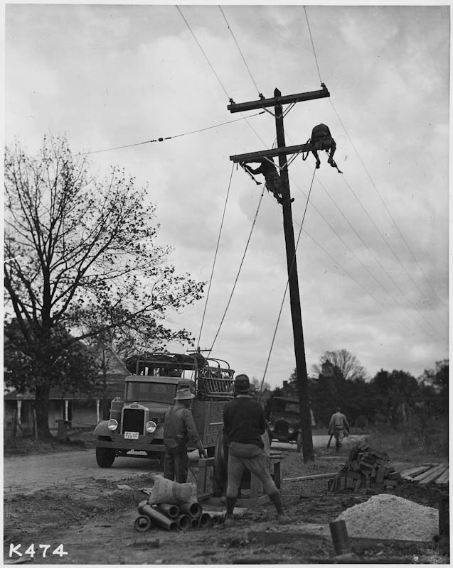Men working on electrical lines.